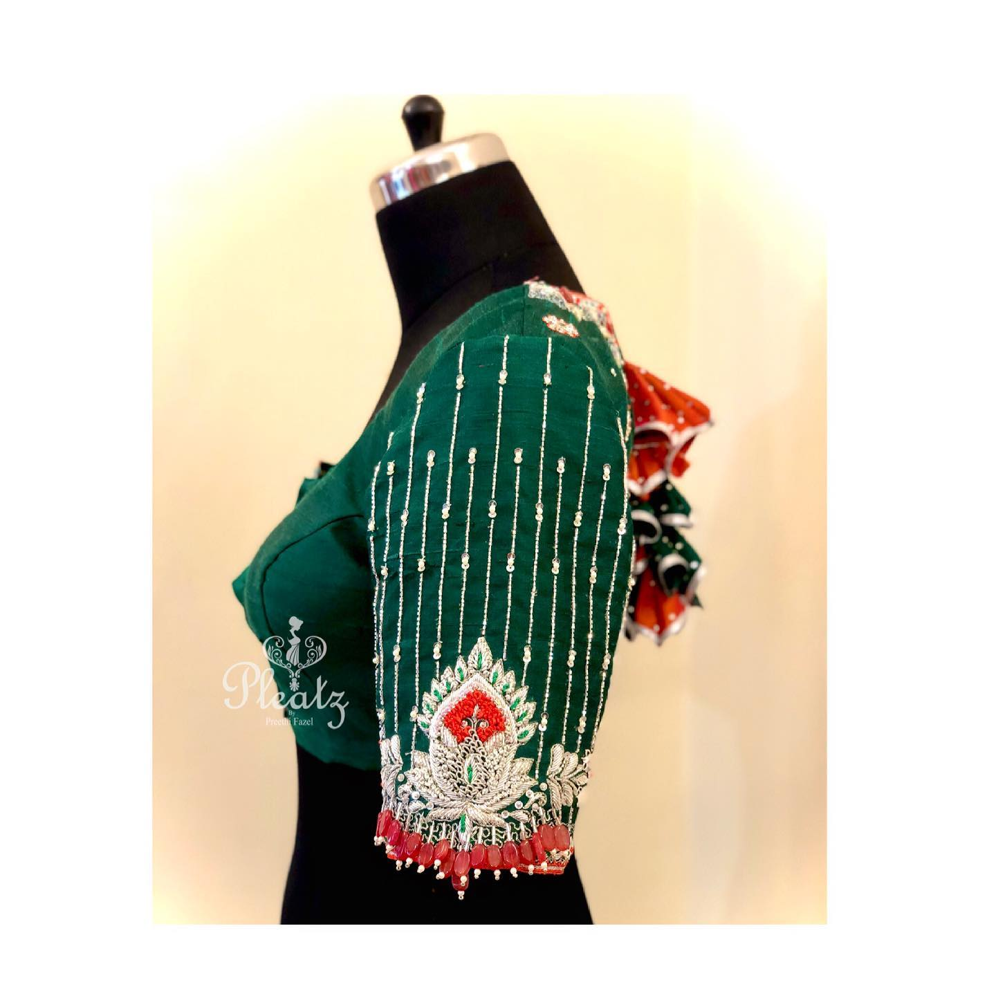 And this beauty got ready today! Love the sleeve work . Stunning bottle green color designer blouse with hand embroidery work on sleeves.  2021-03-06