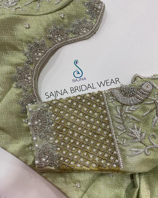 Gorgeous pista green color bridal blouse with floret lata design and parrots hand embroidery silver thread and bead aari work. 2021-03-07