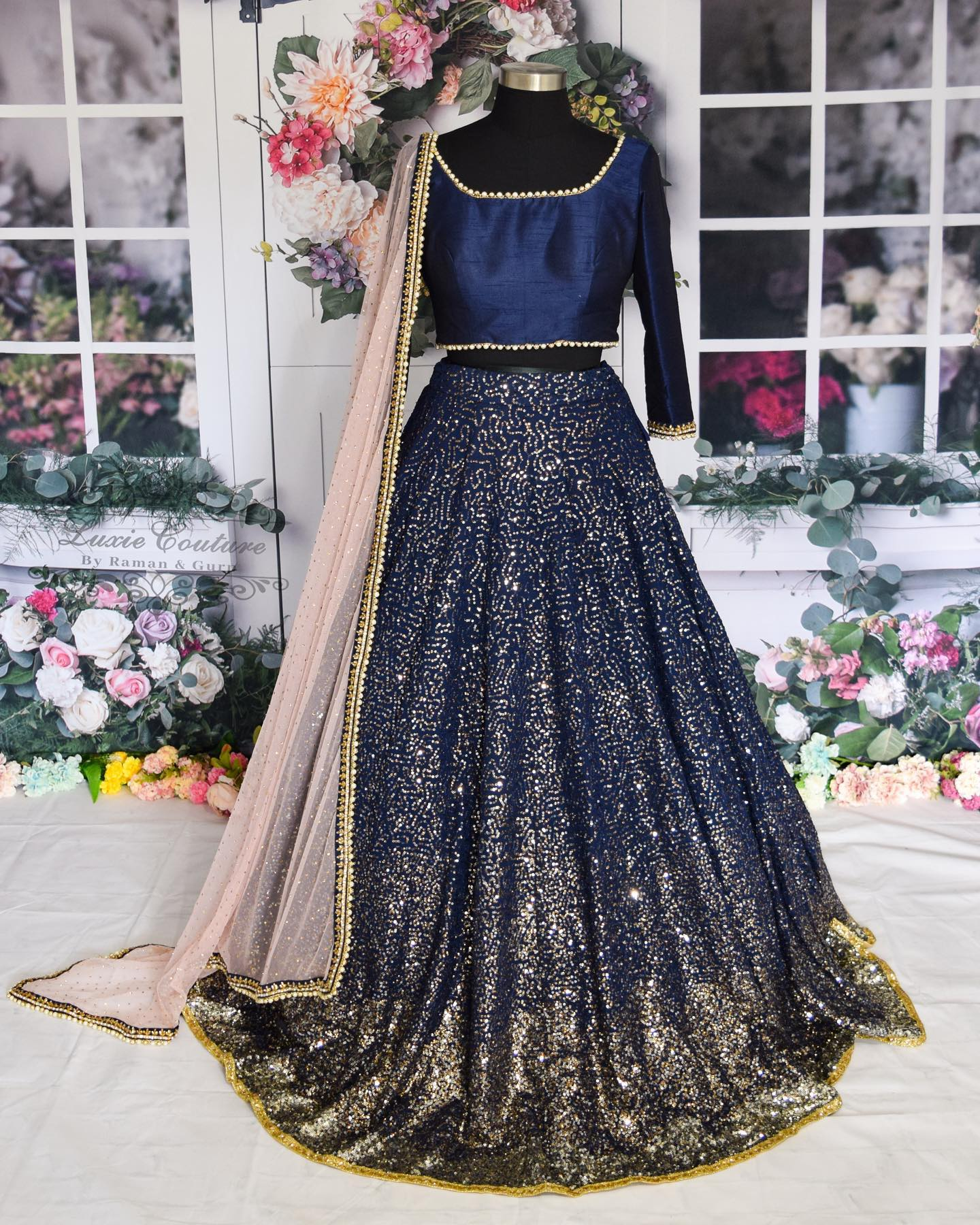 Gorgeous deep blue color sequence lehenga and blouse with blush pink color net duaptta. 2021-03-08