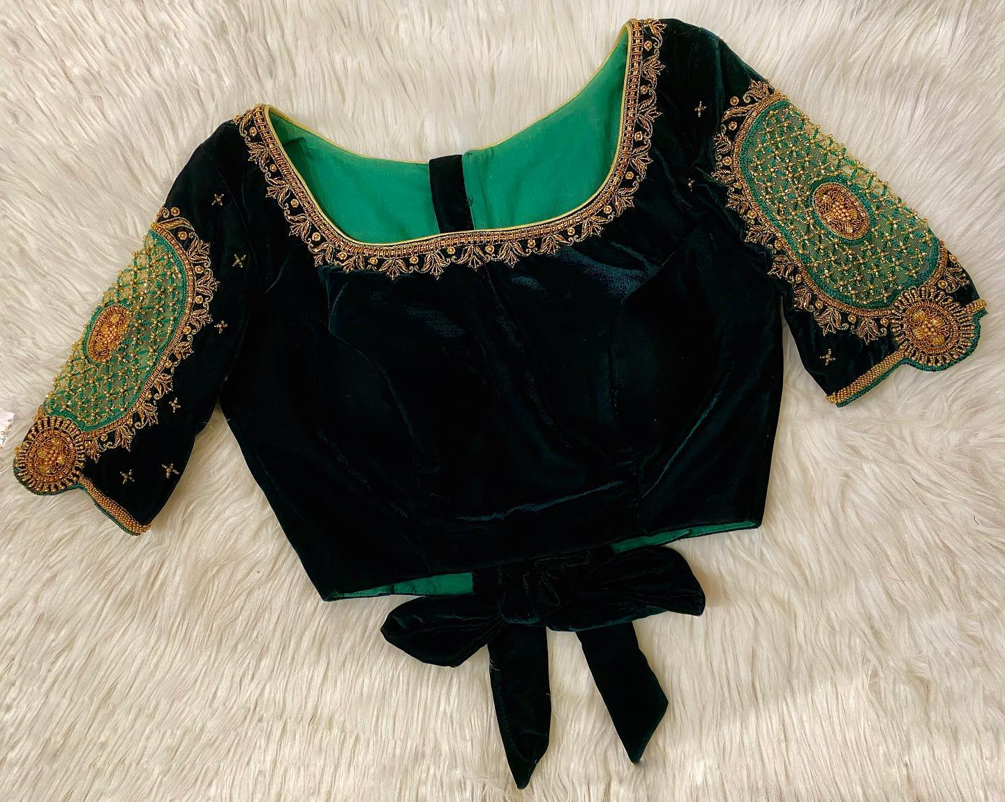 Beautiful green velvet blouse with cut work on sleeves and hand embroidery aari work on neckline. 2021-03-09