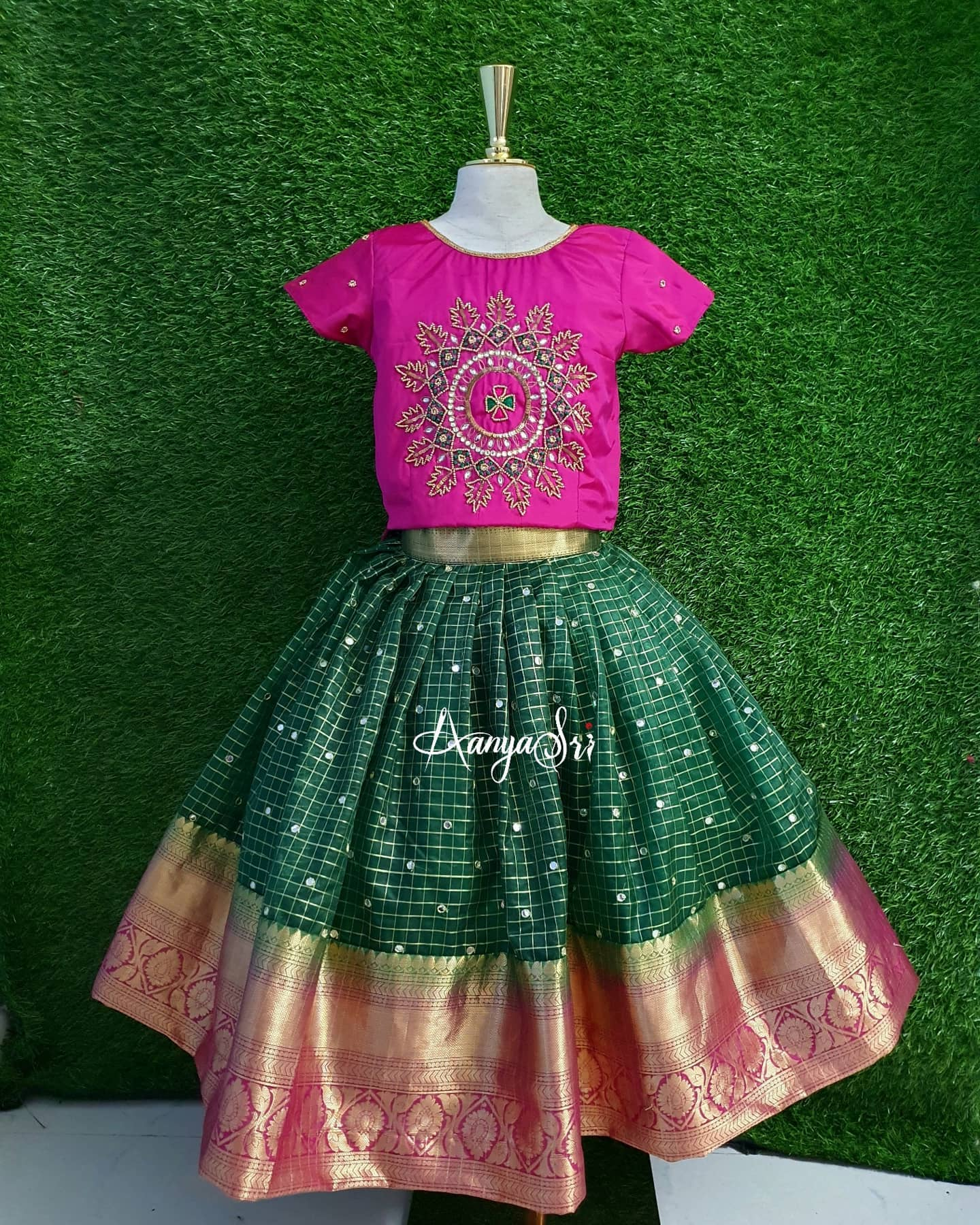 Cute little outfits for your little angels . Stunning bottle green color kids kanchi pattu lehenga and pink color top. 2021-03-11