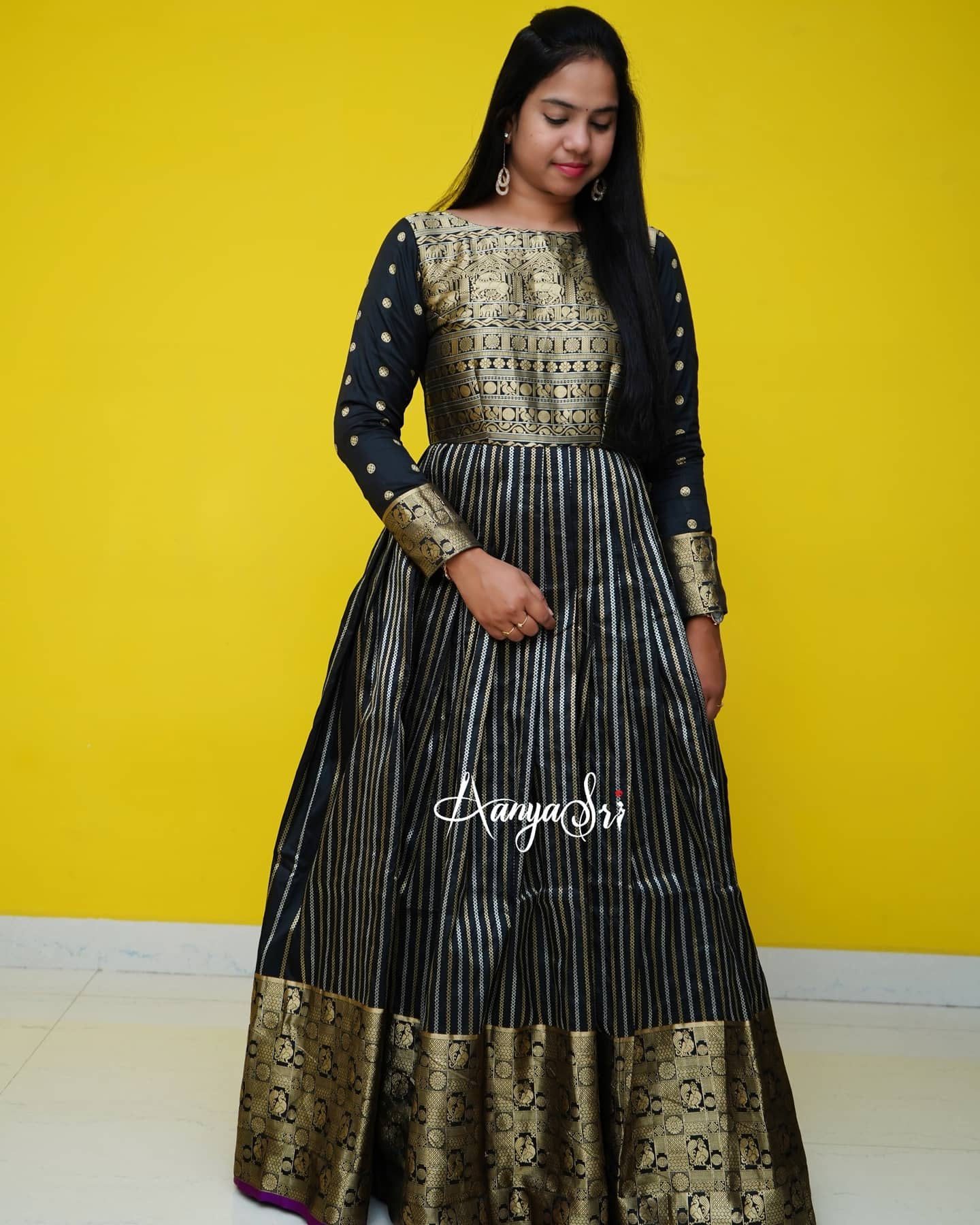 Time takes life away and gives us memory gold with flame black with embers. Beautiful black color kanchi pattu long frock with full sleeves and cut work dupatta.  2021-03-11