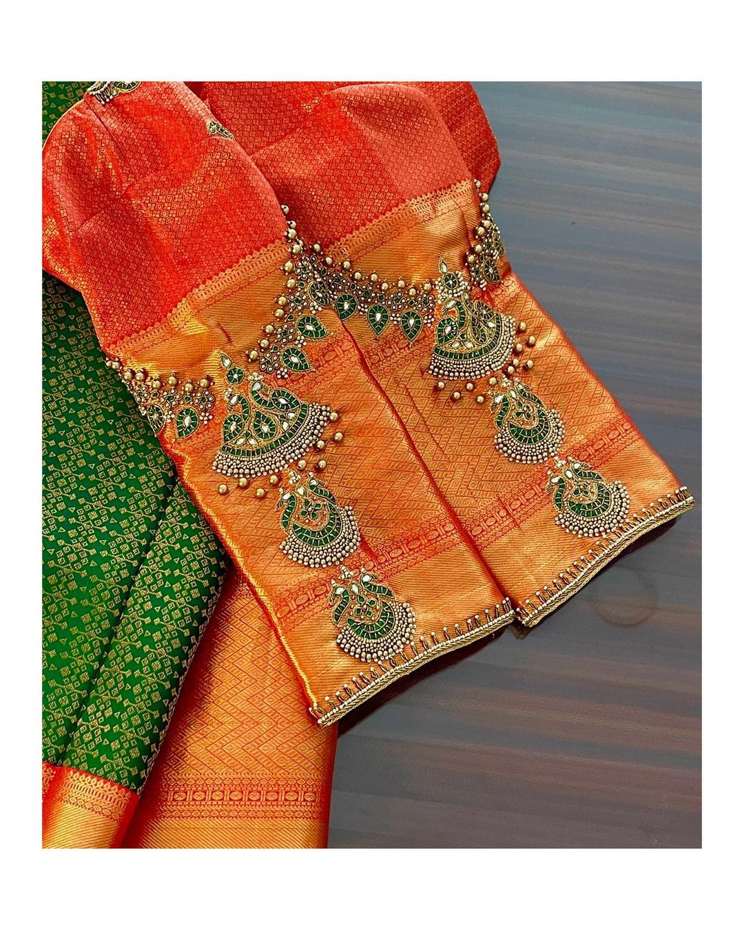 They convert our dream jewellery designs to embroidery on outfits. Stunning designer blouse with necklace theme hand embroidery work sleeves.  2021-03-12