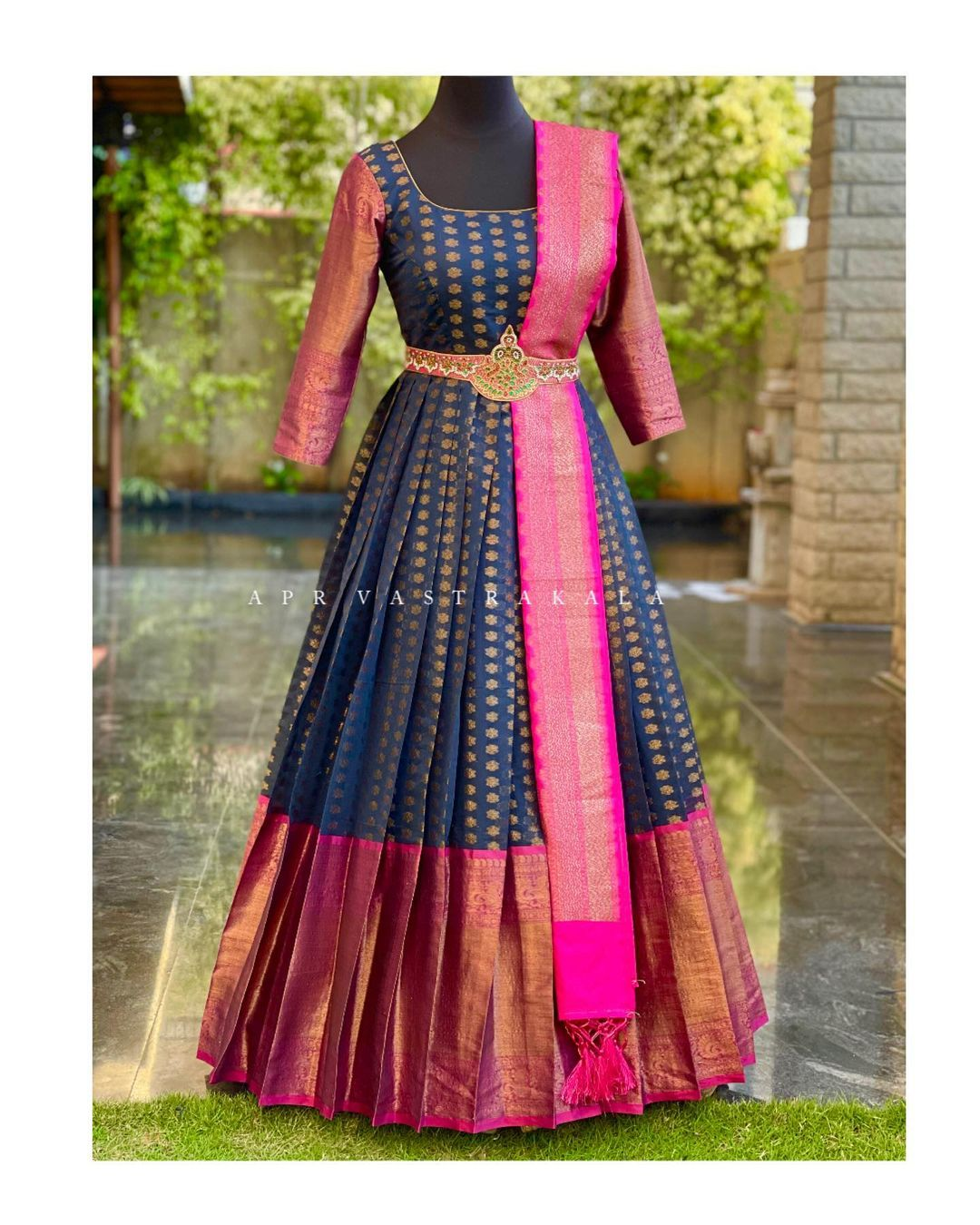 Gorgeous peacock blue and pink color combination pattu long frock with pattu dupatta and hand embroidery waist belt.    2021-03-12