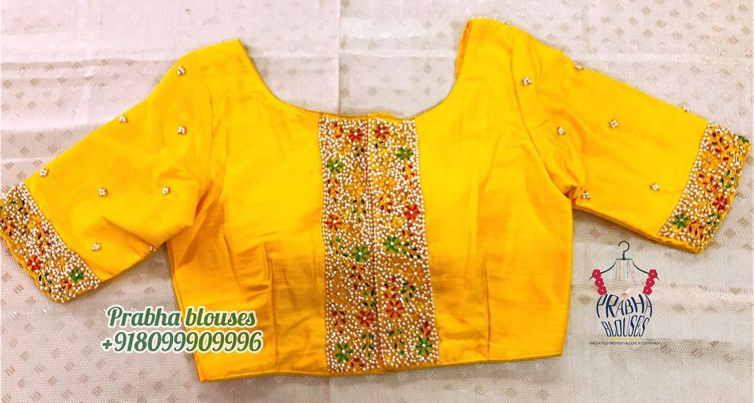 Stunning yellow color designer blouse with guttapusalu hand embroidery work.  2021-03-13