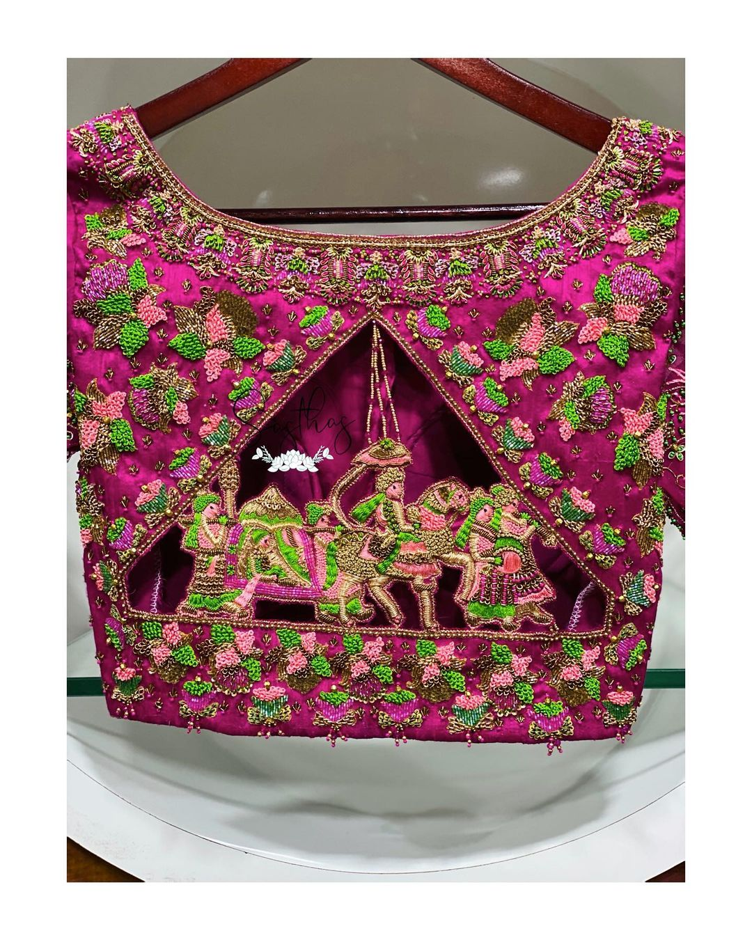 Gorgeous lovely pink color designer blouse with baaraat design hand embroidery cut and maggam work.  2021-03-15