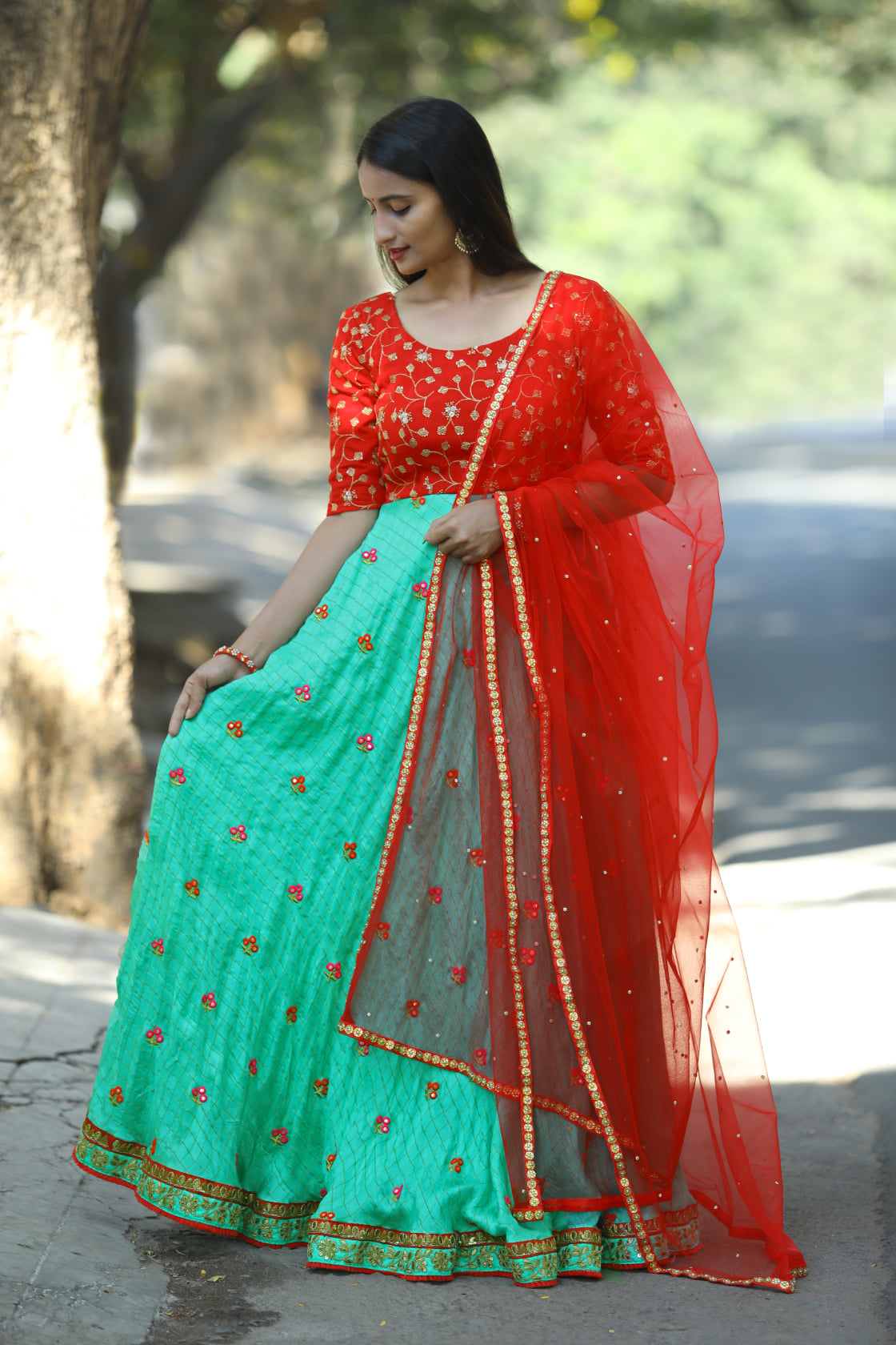 Gorgeous red and sea green color combination floor length anarkali dress with red net dupatta. anarkali dress with hand embroidery work on yoke.  2021-03-18