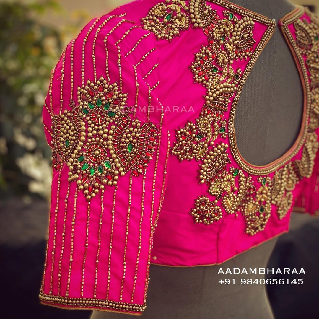 Here is an exclusive hand worked blouse by Aadambharaa that is a melange of simplicity and sophistication. Stunning pink color designer blouse with beaad aari work. 2021-03-18