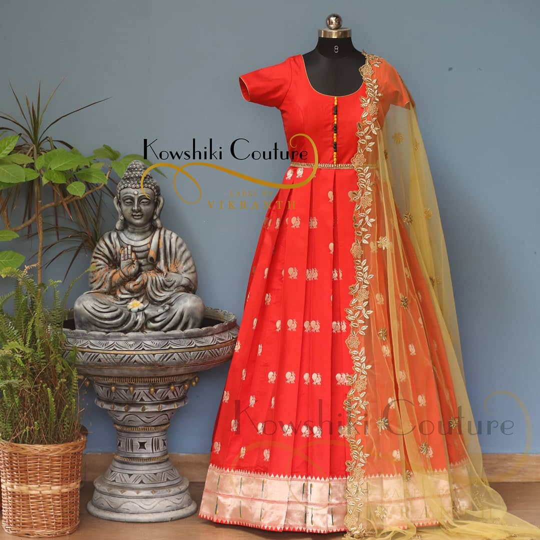 Beautiful red color pattu long frock with cut work net dupatta. Long Dress with Cutwork duppatta from house of Kowshiki couture. 2021-03-18