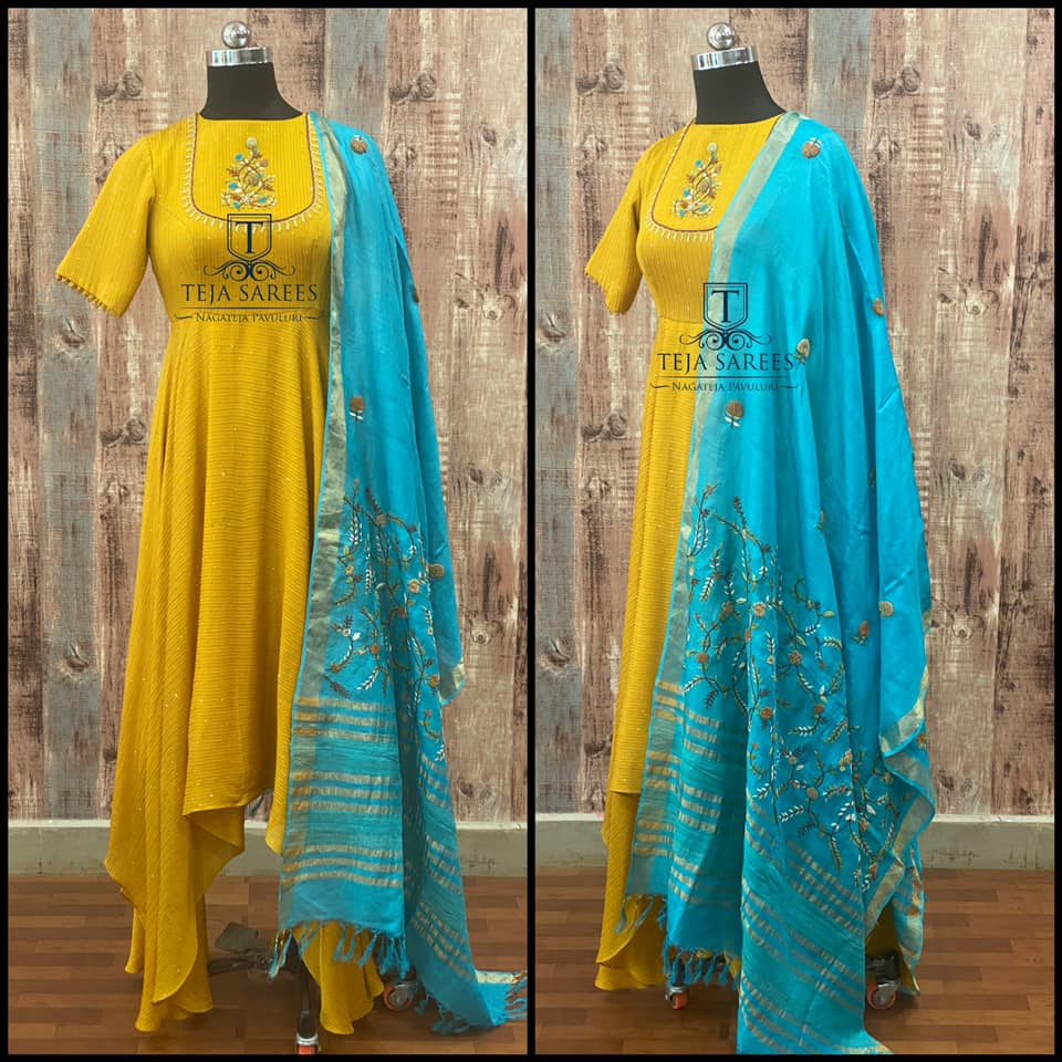 Gorgeous yellow color asymmetric or high low dress with blue dupatta. Dress with hand embroidery work on yoke.  2021-03-20