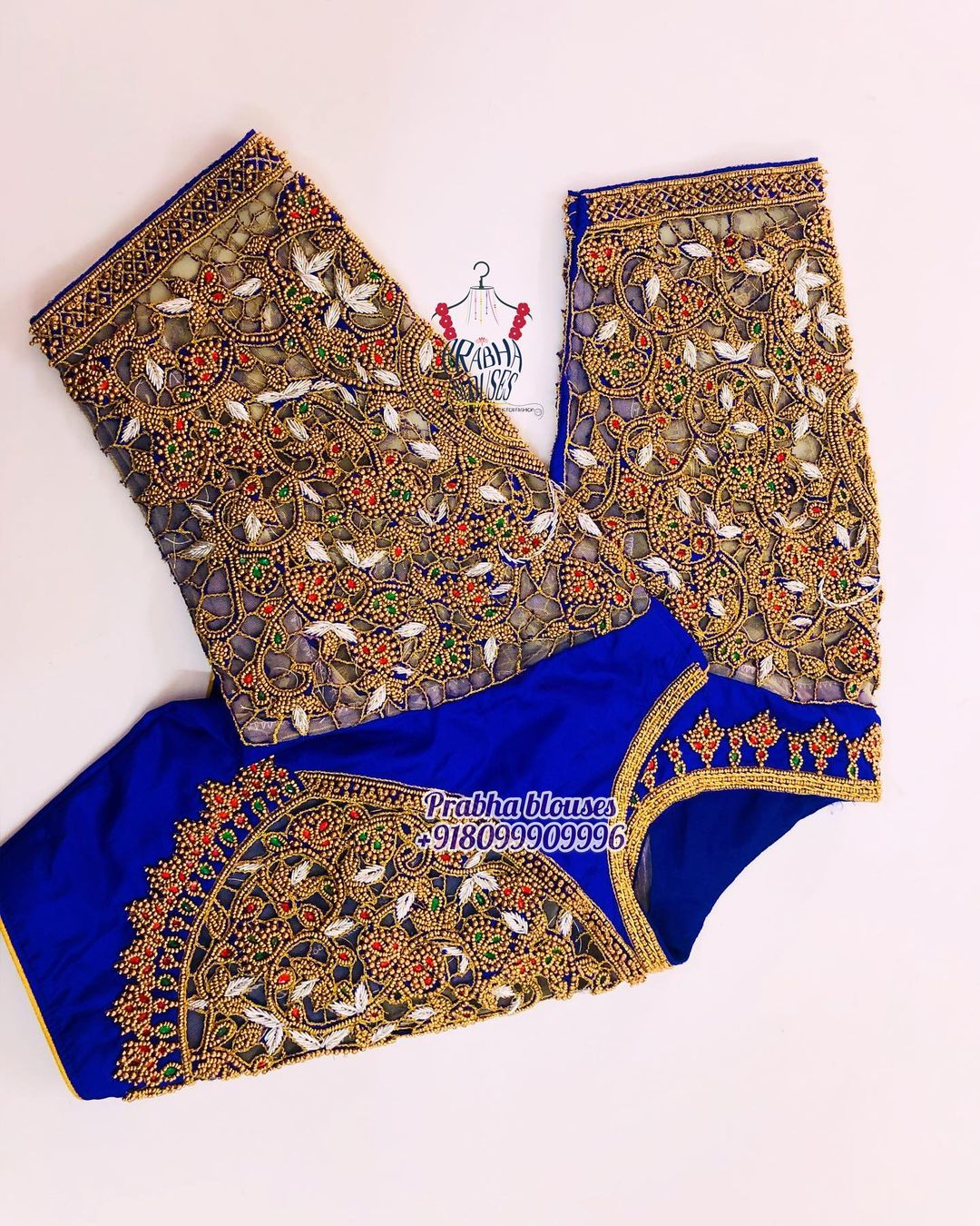 Gorgeous royal blue color designer blouse with floral design hand embroidery bead aari and cut work.  2021-03-20