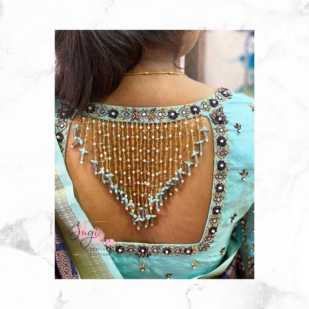 Gorgeous ice blue color trendy blouse with bead aari work on sleeves and back. 2021-03-20