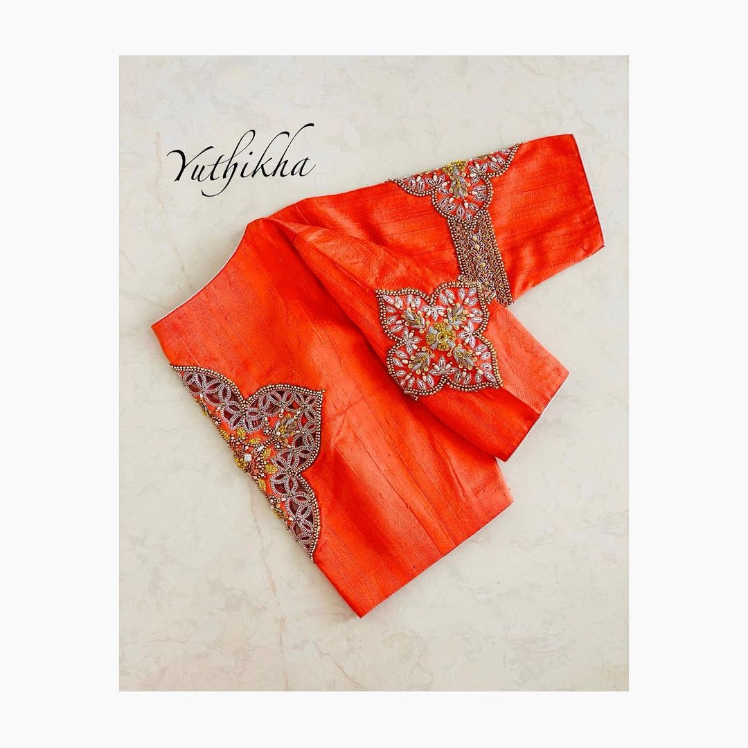 Stylish fanta orange color cutwork embroidery blouse from the house of yuthikha designer studio !!! For appointments contact 9894231384. 2021-03-20