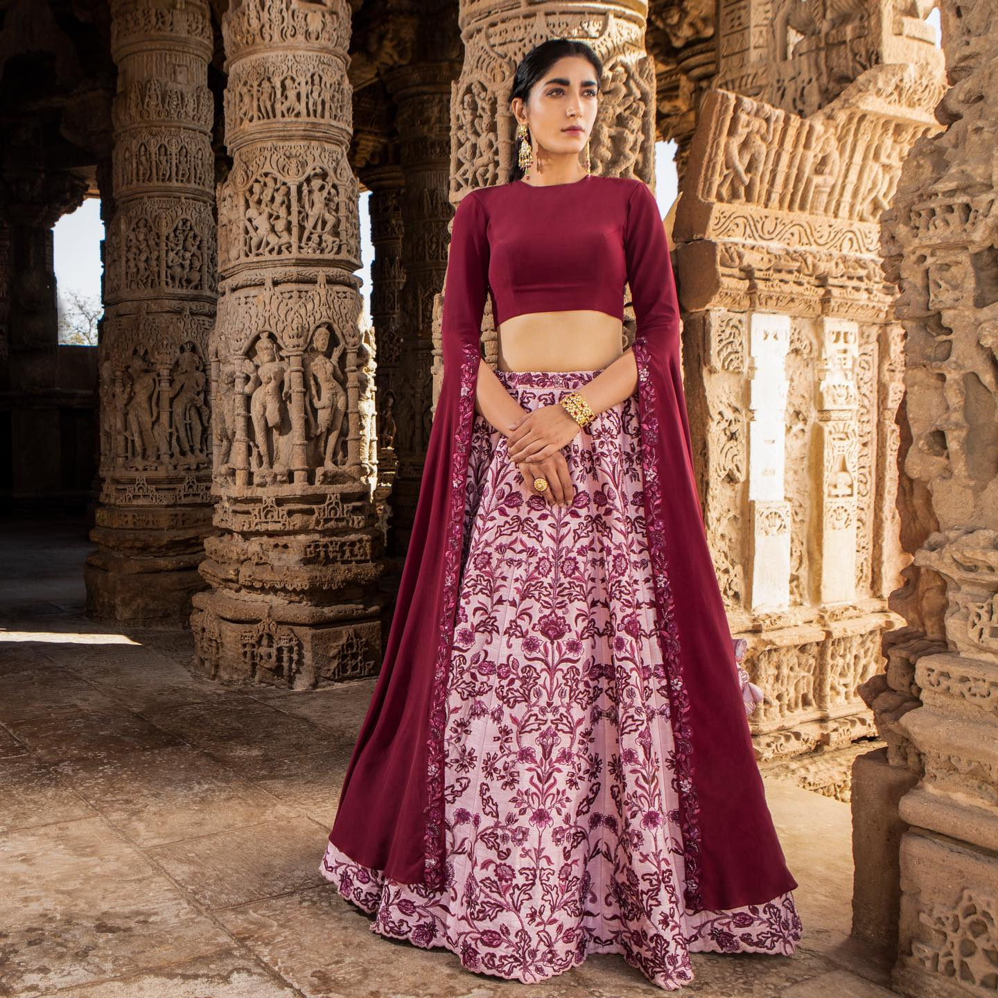 Stunning blush pink color skirt and wine color crop top with long cape sleeves. Skirt with classy hand embroidery work.  2021-03-21