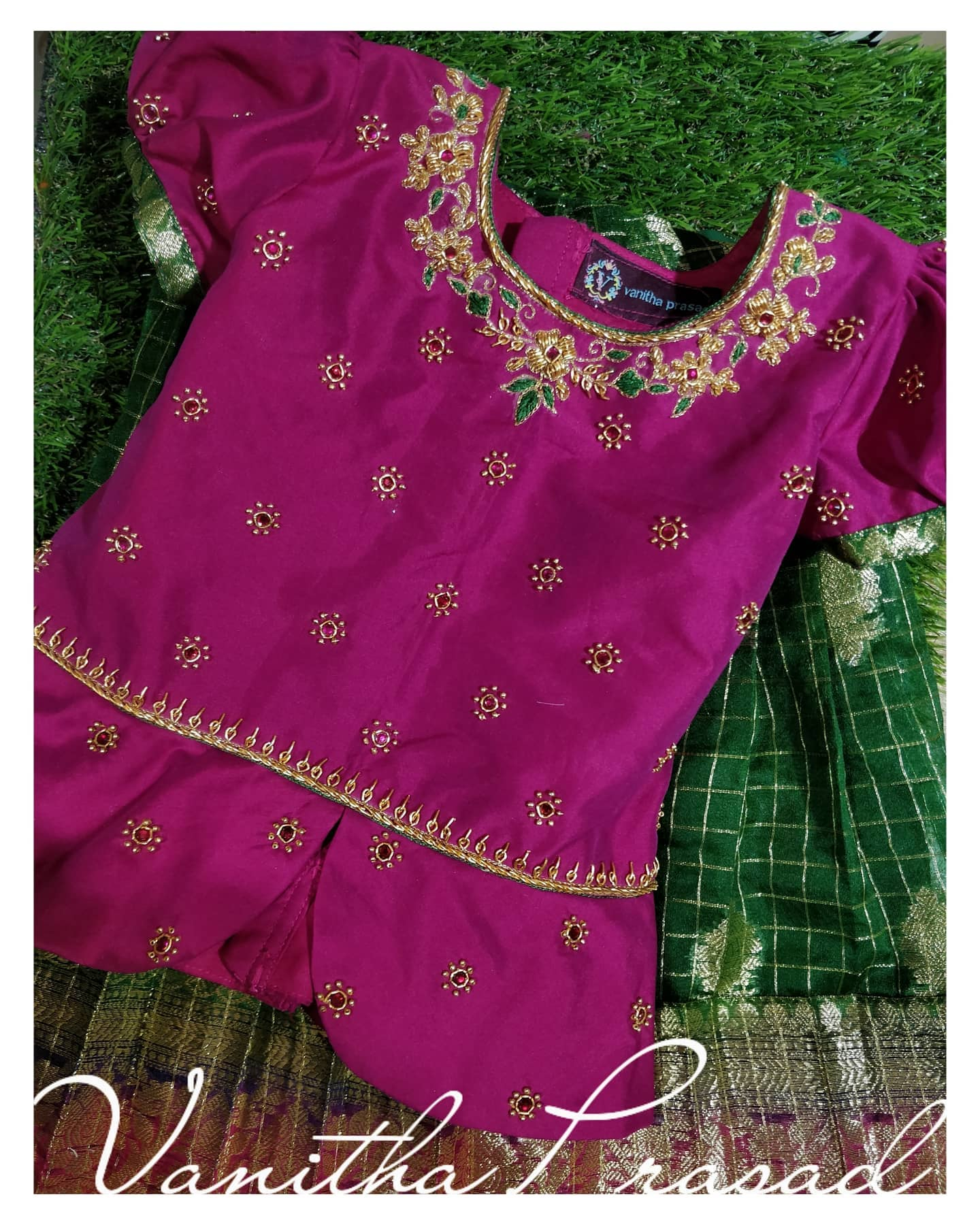 Customised ethnics for a year old baby. They matched the colours to her mom's saree. Beautiful pink color kids peplum top with floral hand embroidery aari work on neckline.  2021-03-22