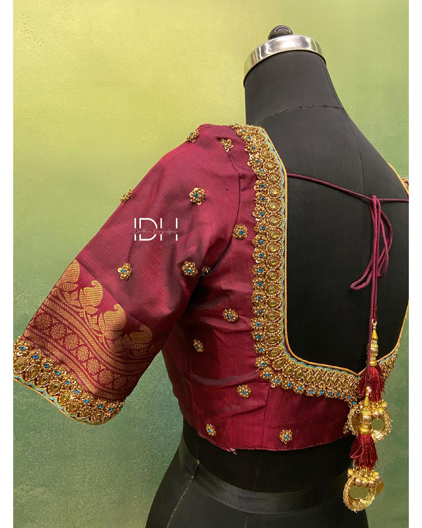 Gorgeous wine color bridal blouse with floral and mango buti design hand embroidery bead aari work on neckline and sleeves.  2021-03-22