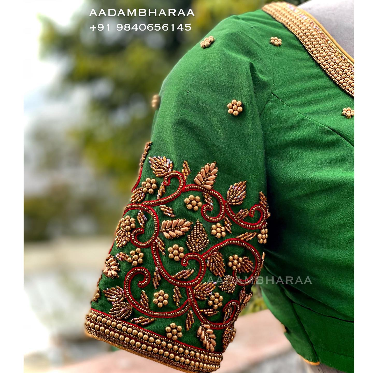 Gorgeous green color bridal blouse with floral and creeper design hand embroidery bead aari work on sleeves and neckline.  Here is an exclusive hand worked blouse by Aadambharaa that is a melange of simplicity and sophistication.