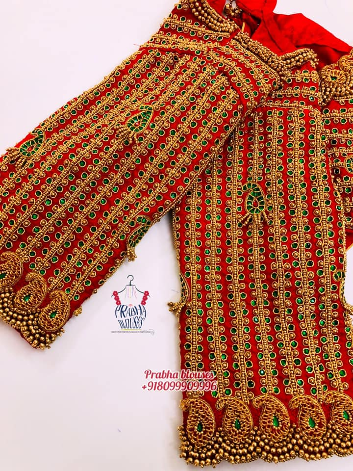 Stunning red color designer blouse with mango design hand embroidery bead and kundan heavy maggam work.  2021-03-22