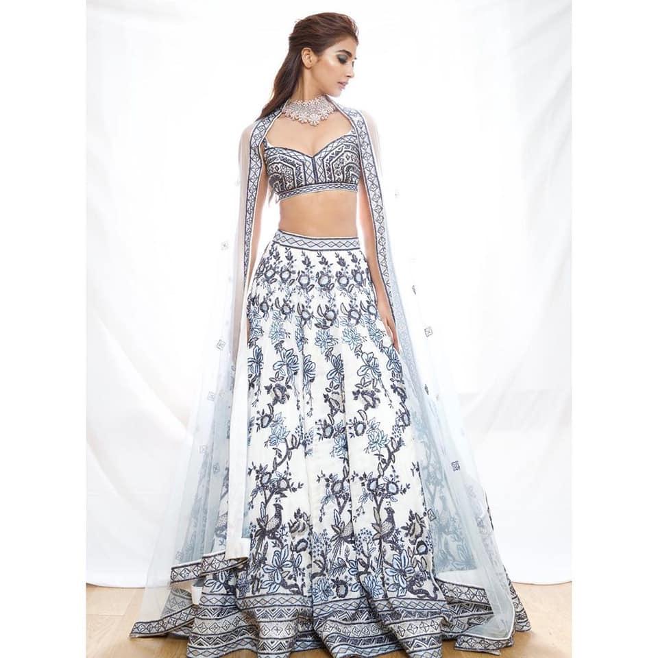 Beautiful actress Pooja Hegde in pearl white designer lehenga set by Varun Chakkilam - Label for Lakme fashion week. 2021-03-24