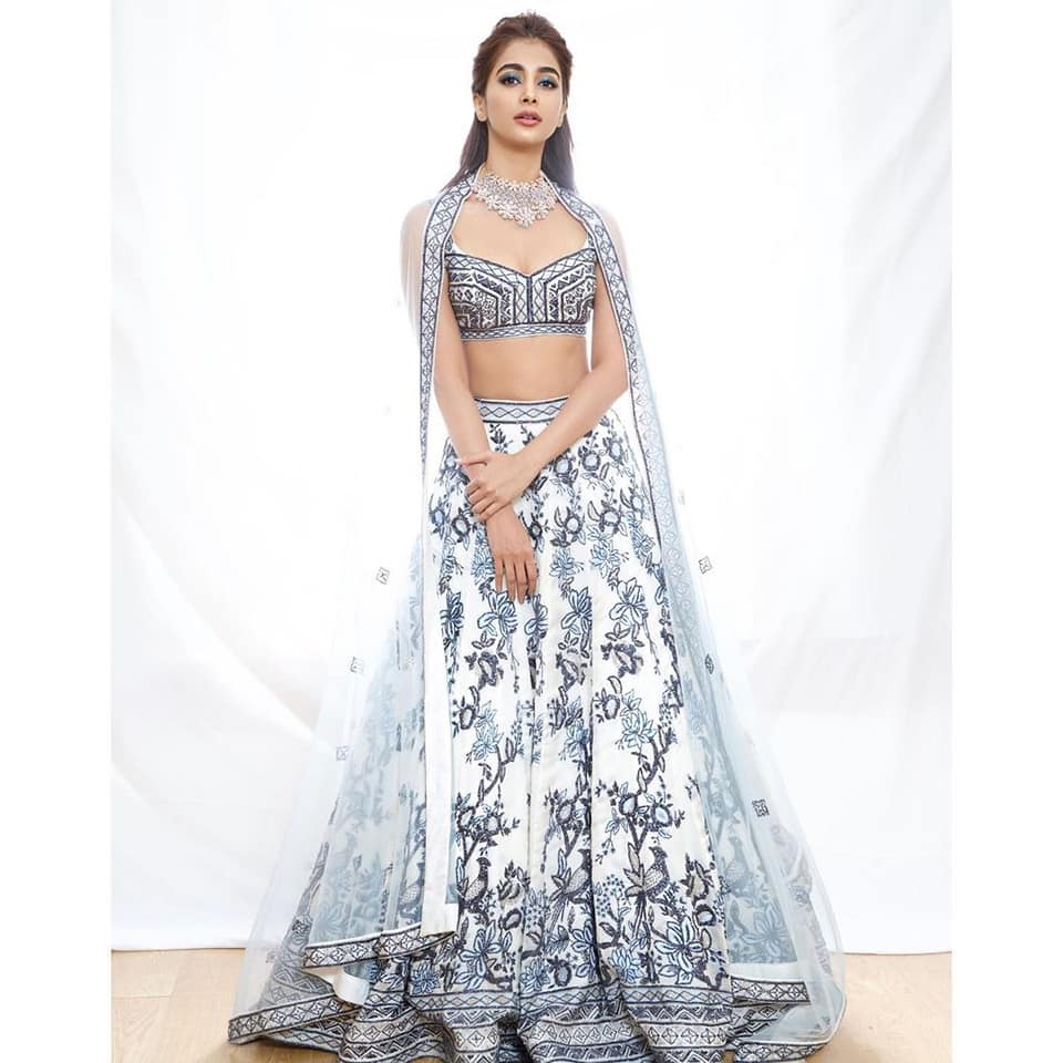 Beautiful actress Pooja Hegde in pearl white designer lehenga set by Varun Chakkilam - Label for Lakme fashion week. 2021-03-24