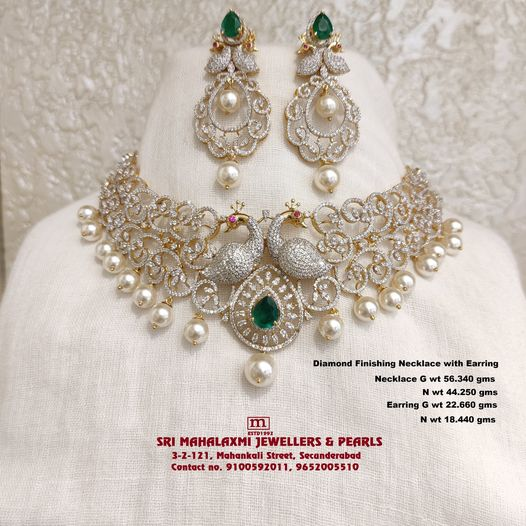 Presenting Here is Diamond Finishing Swaroski Cz`s Peacock Necklace with matching Earring studded with Swaroskis cz and change Red Green Color Stones made 18KT BIS HALLMARK Gold 2021-03-25