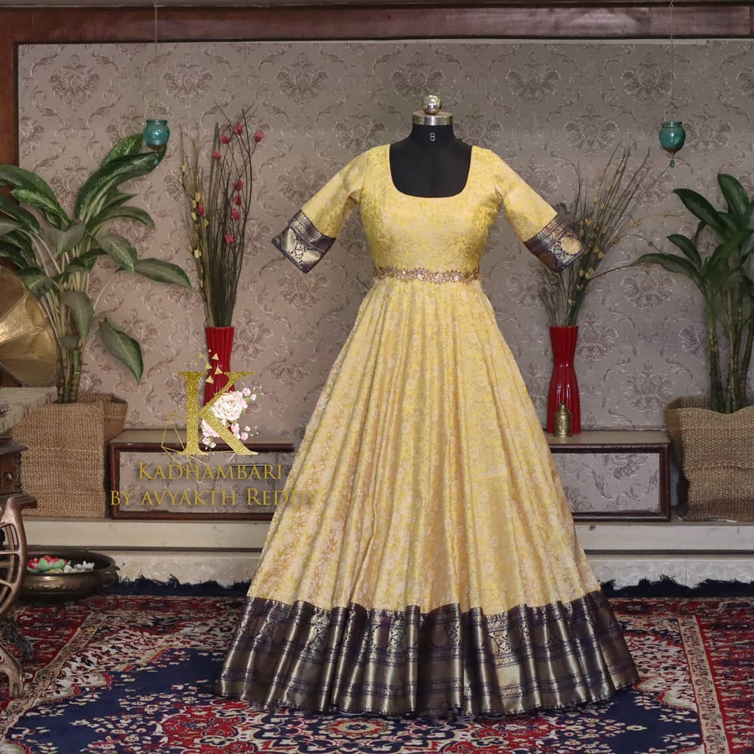 Stunning lime yellow and deep blue color combination  pattu long frock. This outfit is Available at RS 5800/- from house of Kadhambari. They can customize size as per your requirement. THey have international shipping service too. For Orders and Enquiry Reach  on WhatsApp +91 8801876477 //  +91 90634790991 2021-03-25