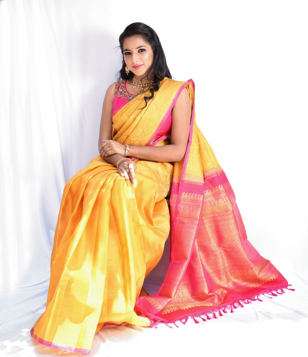 Gorgeous yellow Kanchi organza silk saree with contrasting pink pallu! Swipe to see the exquisite creeper detailings on the saree. Exquisite zardosi embellishments on pink Kanchi silk blouse! 2021-03-26