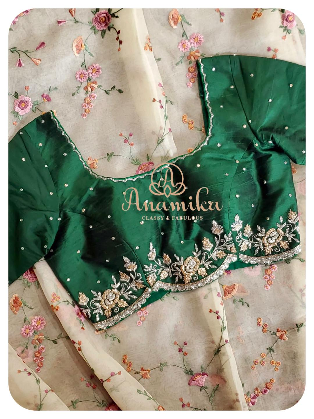 Stunning pearl white color floral saree and bottle green color blouse with hand embroidery work. Saree with floral hand embroidery work.   2021-03-26