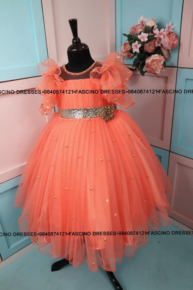 A peach kids gown beauty by fascino. 