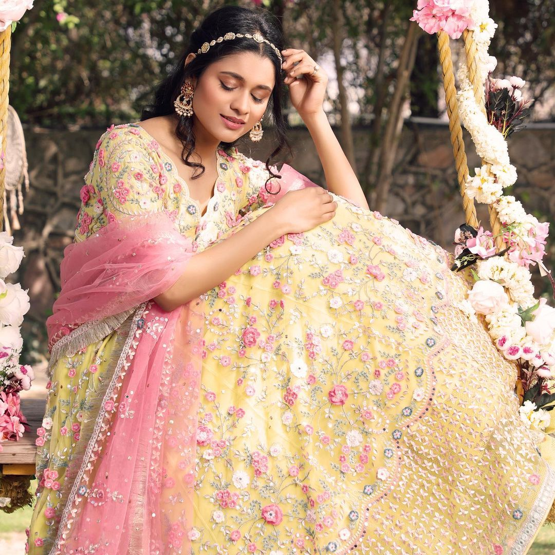 Nutan Lehenga. Stunning summer yellow color designer lehenga and blouse with blush pink color tulle dupatta. Lehenga and blouse with classy hand embroidery work. 