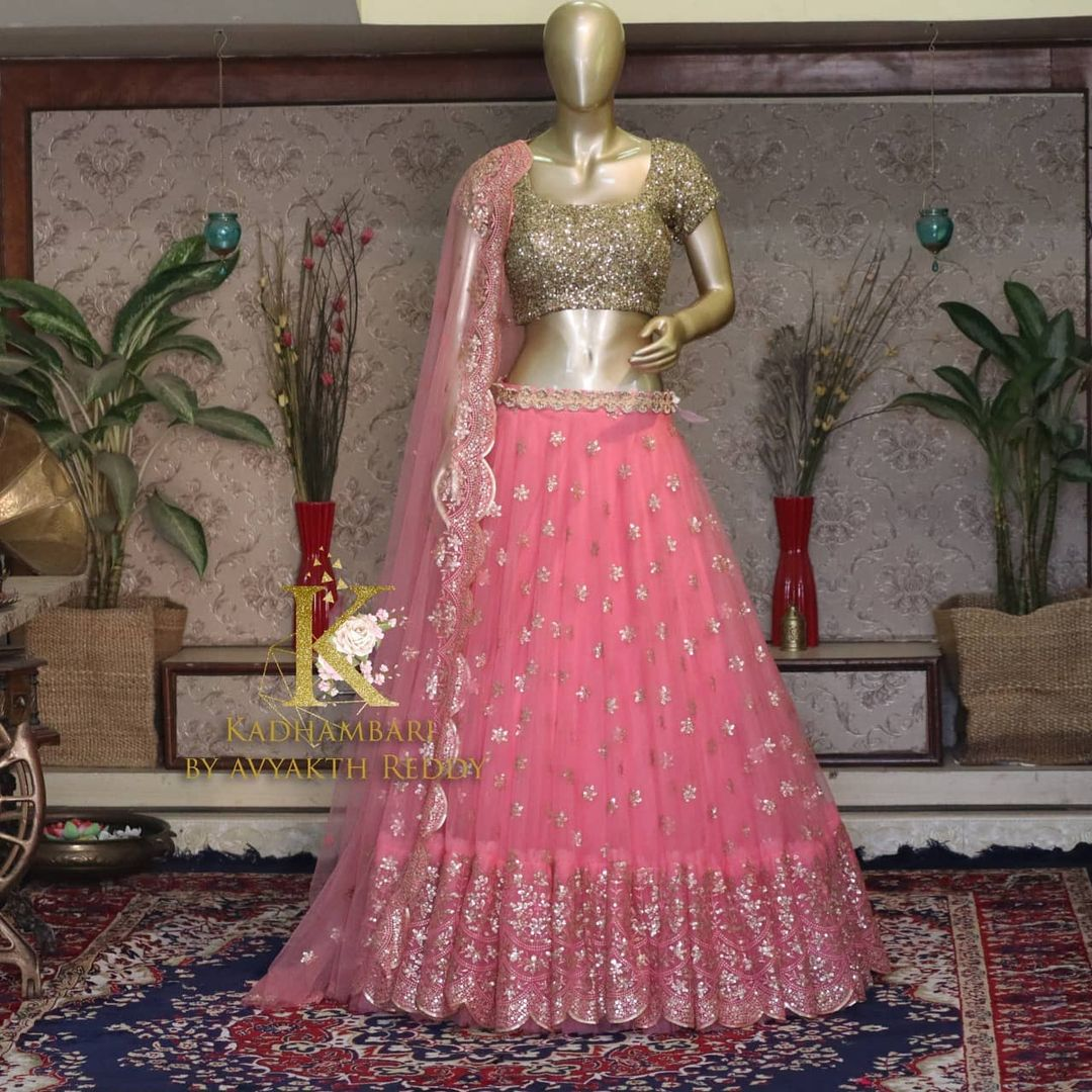 Gorgeous blush pink color net lehenga and gold sequin blouse with net dupatta. This outfit is Available at Rs 13800/- from house of Kadhambari. They can customize size as per your requirement. They have international shipping service too. For Orders and Enquiry Reach  on WhatsApp +91 8801876477 // +91 9063479099 2021-03-28