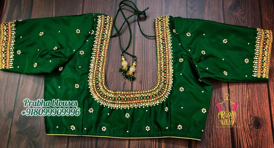 Stunning leaf green color designer blouse with floral buti design hand embroidery  stone aari work.  2021-03-30