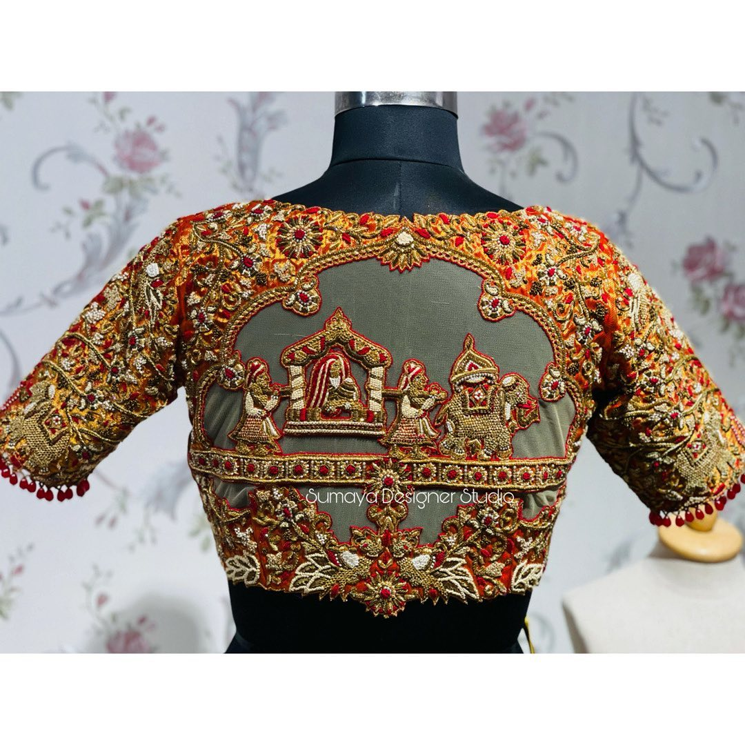 Stunning bridal blouse with doli or pallaki design hand embroidery maggam work. 2021-03-30