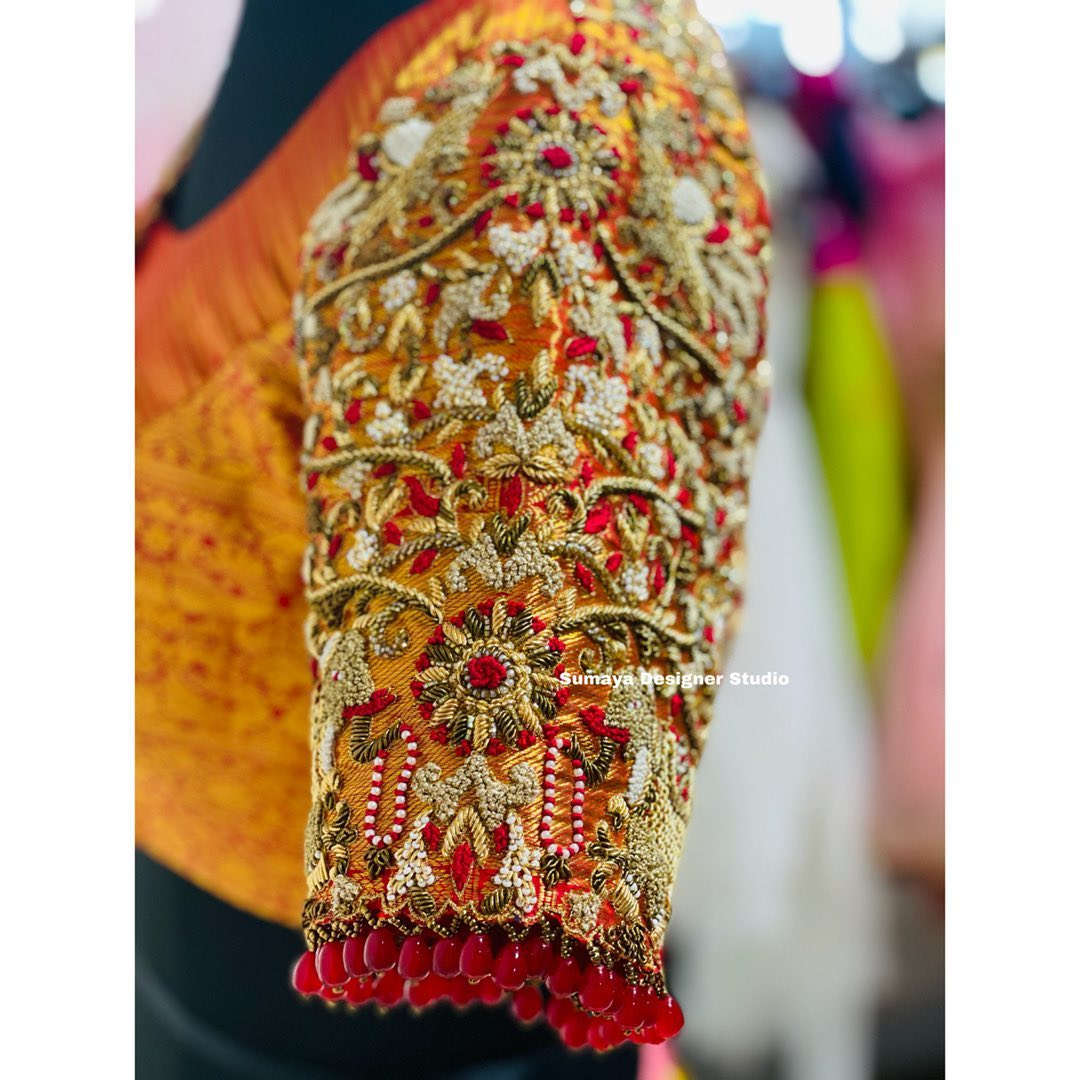 Stunning designer bridal blouse sleeve with elephant peacock and floral design bead and thread maggam work. 2021-03-30