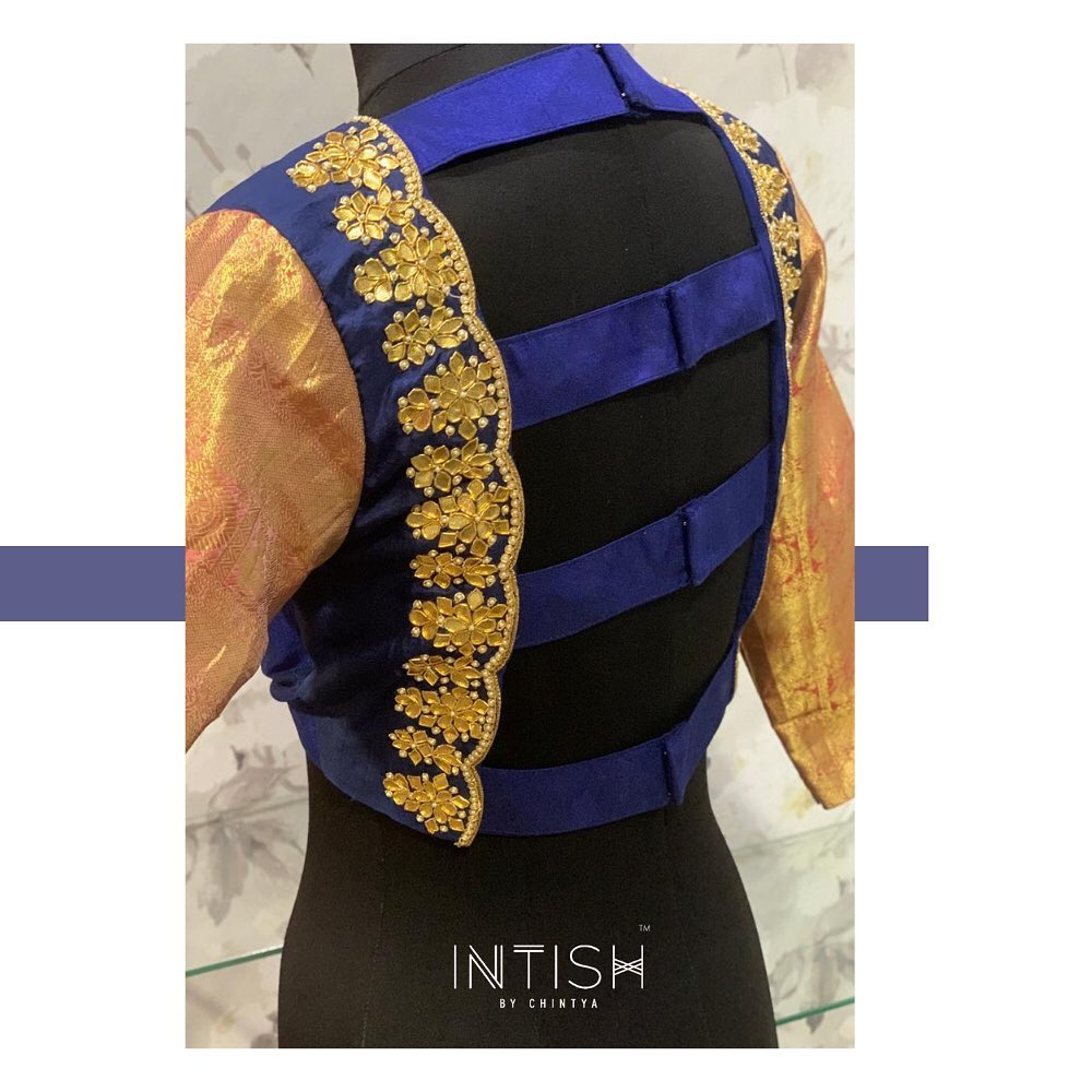 No more boring blouses! Bringing sexy back! Gorgeous deep navy blue color designer blouse with zari sleeves. Blouse with floral kundan hand embroidery aari work.   2021-03-31