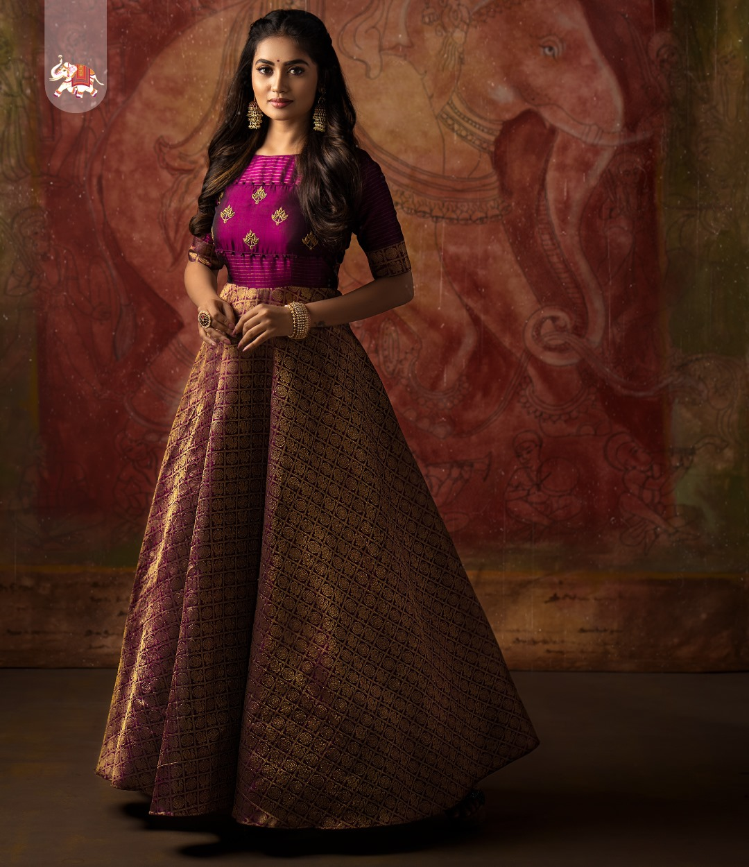 Beautiful purple color kanchi pattu umbrella cut anarkali dress with orange color pattu dupatta. Customization at its best! Get gorgeous customized outfits for your special occasions.  2021-03-31