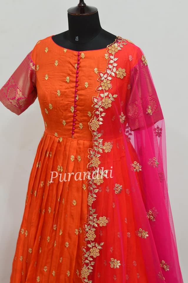 Gorgeous orange and pink color combination pattu long frock with net dupatta. Long frock with pattu sleeves. Dupatta with cut work. 2021-03-31
