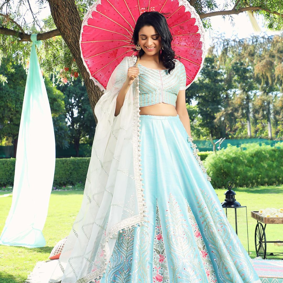 Gorgeous ice blue color  Umbrella Lehenga and blouse with white net dupatta. Lehenga and blouse with classy hand embroidery work.  2021-03-31