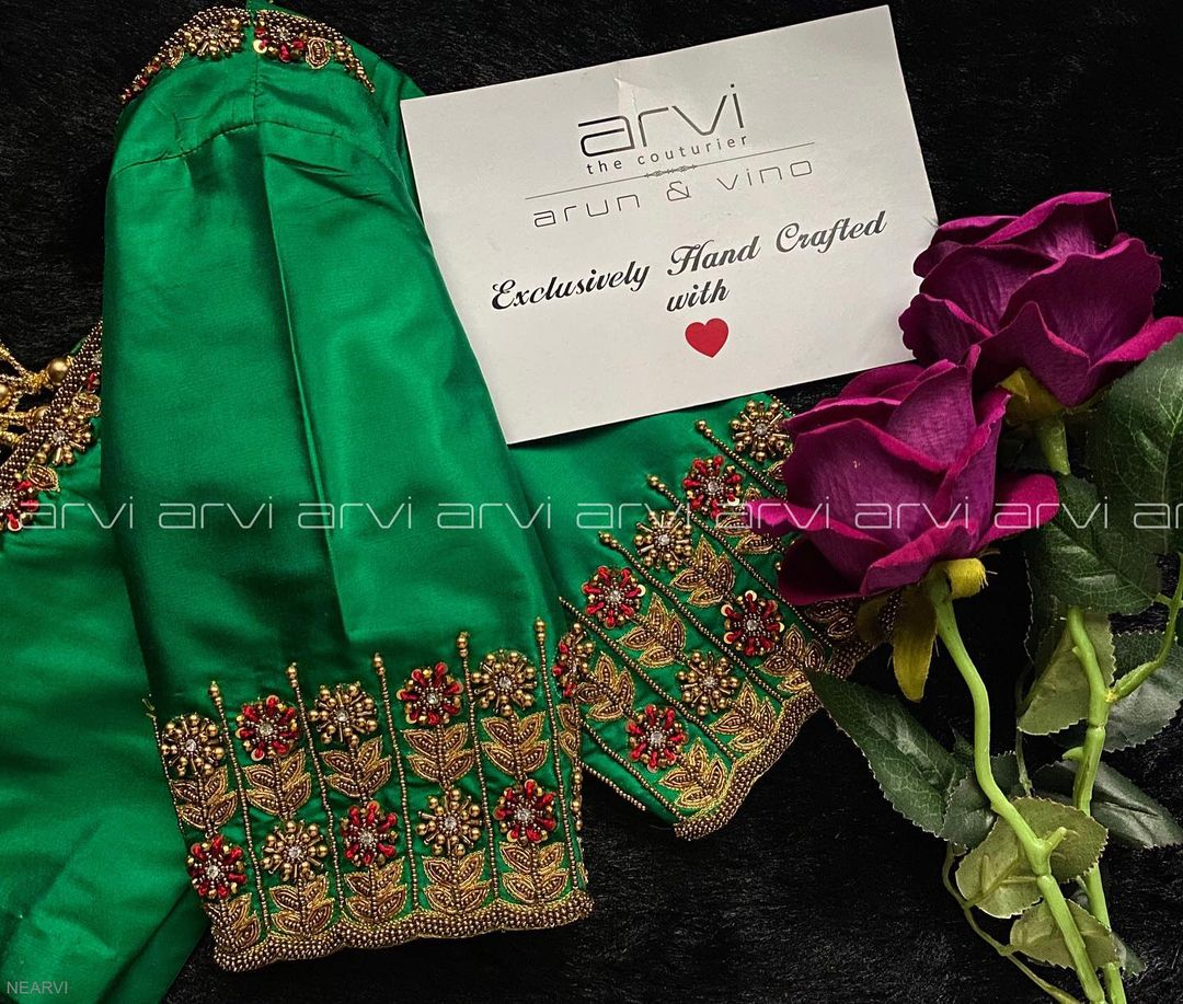Stunning leaf green color designer blouse with bead and stone aari work on neckline and sleeves. 2021-04-01