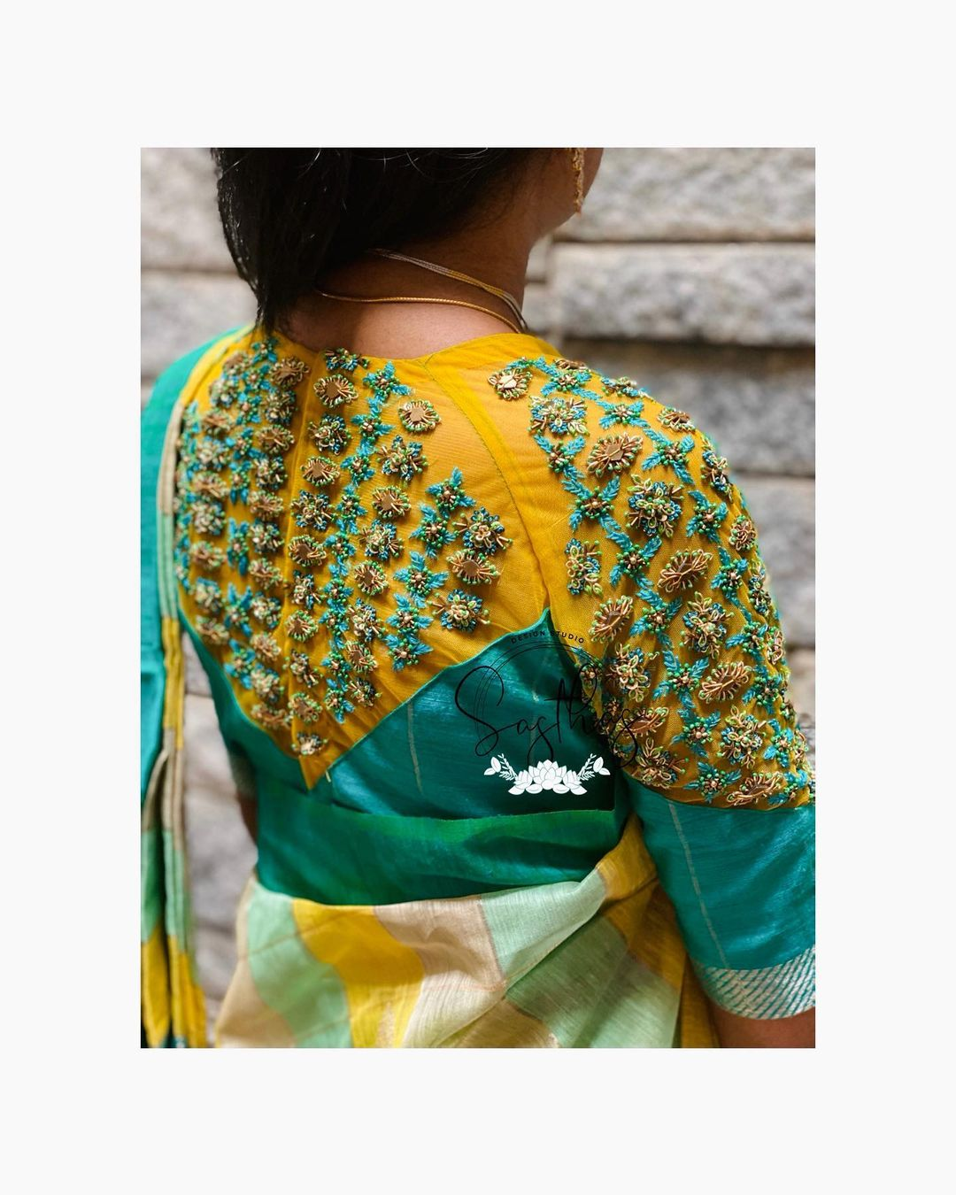 Gorgeous yellow and sea green color combination trendy cut blouse with bead and stone aari work. 2021-04-01
