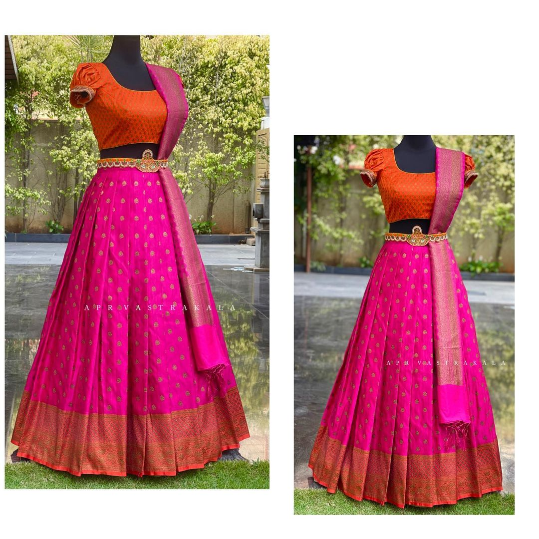 Gorgeous pink color kanchi pattu lehenga and orange color short puff sleeves with pattu dupatta. 2021-04-01