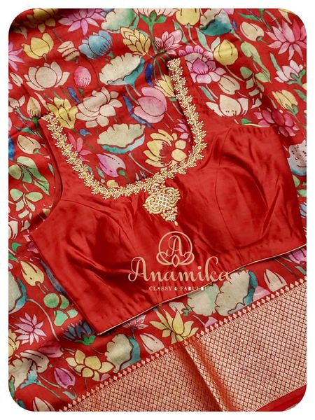 A woman just needs two things to look beautiful - a red saree and a red lipstick ! This beautiful red munga silk floral saree paired with a matching red sleeveless work blouse is simply stunning