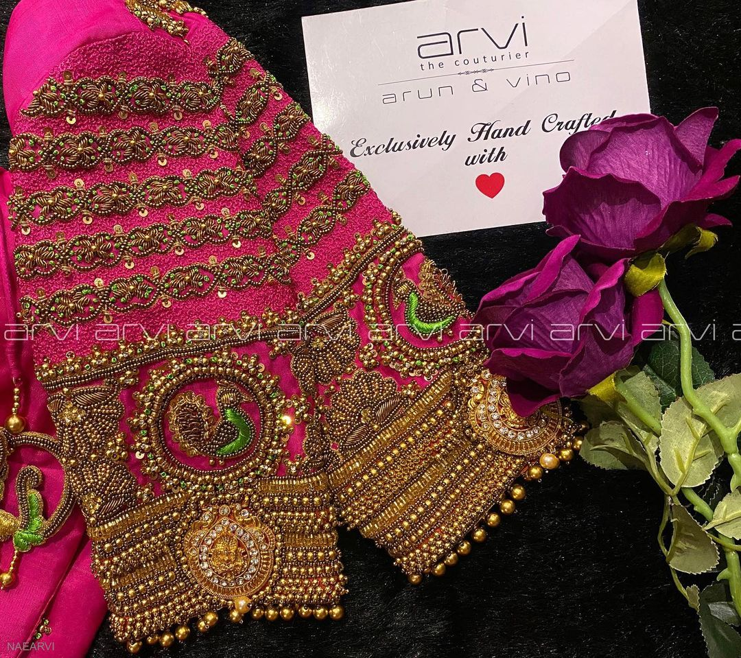 Stunning pink color designer blouse with peacock and Lakshmi devi motifs. Blouse with peacock cut work tassels. Blouse with bead aari work. 2021-04-02
