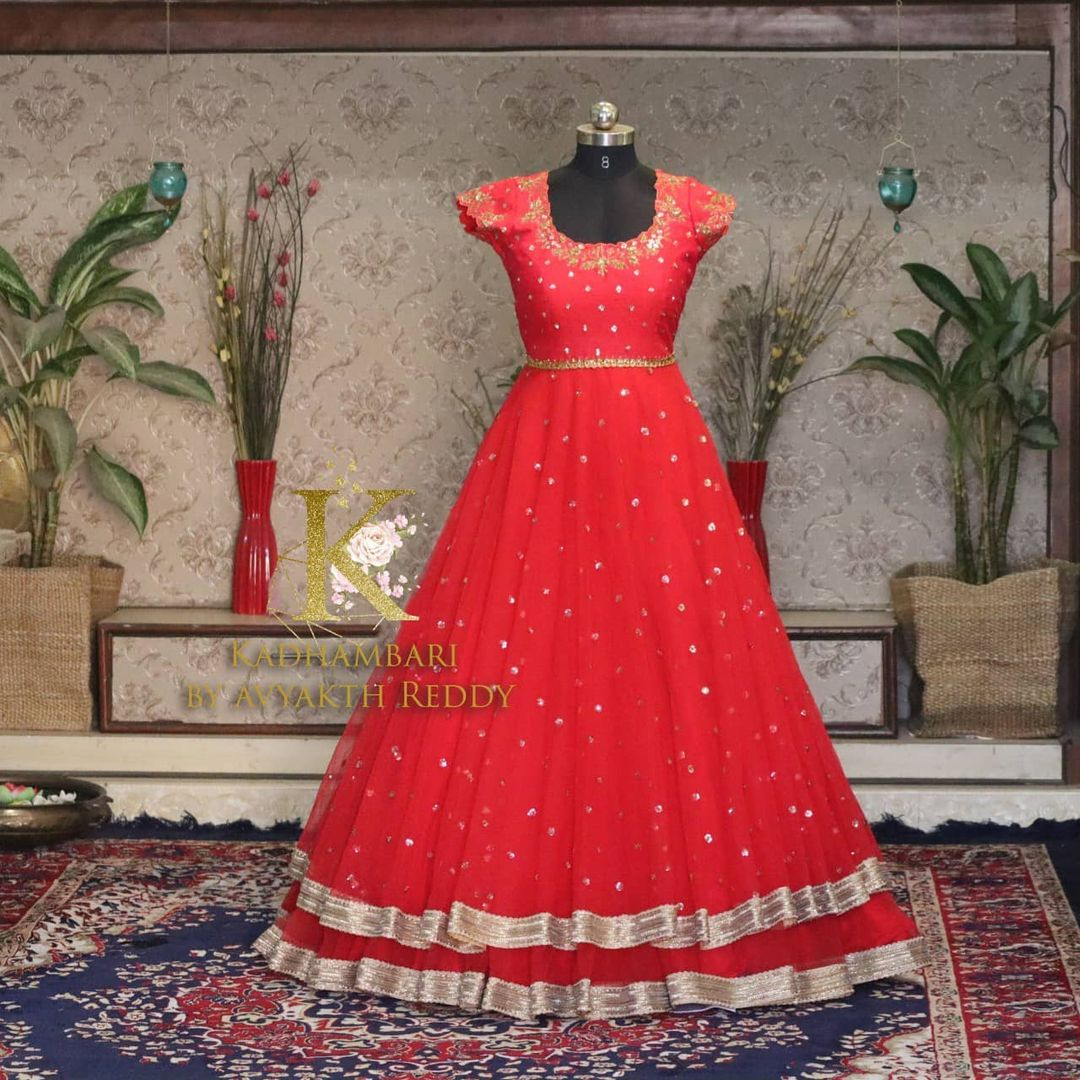 Stunning red color umbrella cut floor length long dress. This outfit is Available at Rs 8000/- Can be customised as lehenga 11800/-from house of Kadhambari. They can customize size as per your requirement. They have international shipping service too. For Orders and Enquiry Reach  on WhatsApp +91 8801876477 // +91 9063479099. 2021-04-02