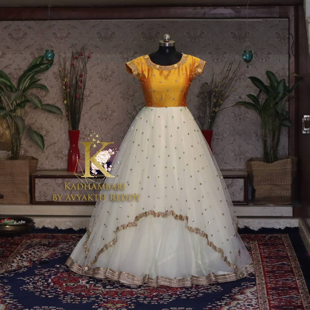 Stunning pearl white and mustard yellow color umbrella cut floor length long dress. This outfit is Available at Rs 8000/- from house of Kadhambari. They can customize size as per your requirement. They have international shipping service too. For Orders and Enquiry Reach  on WhatsApp +91 8801876477 // +91 9063479099. 2021-04-02
