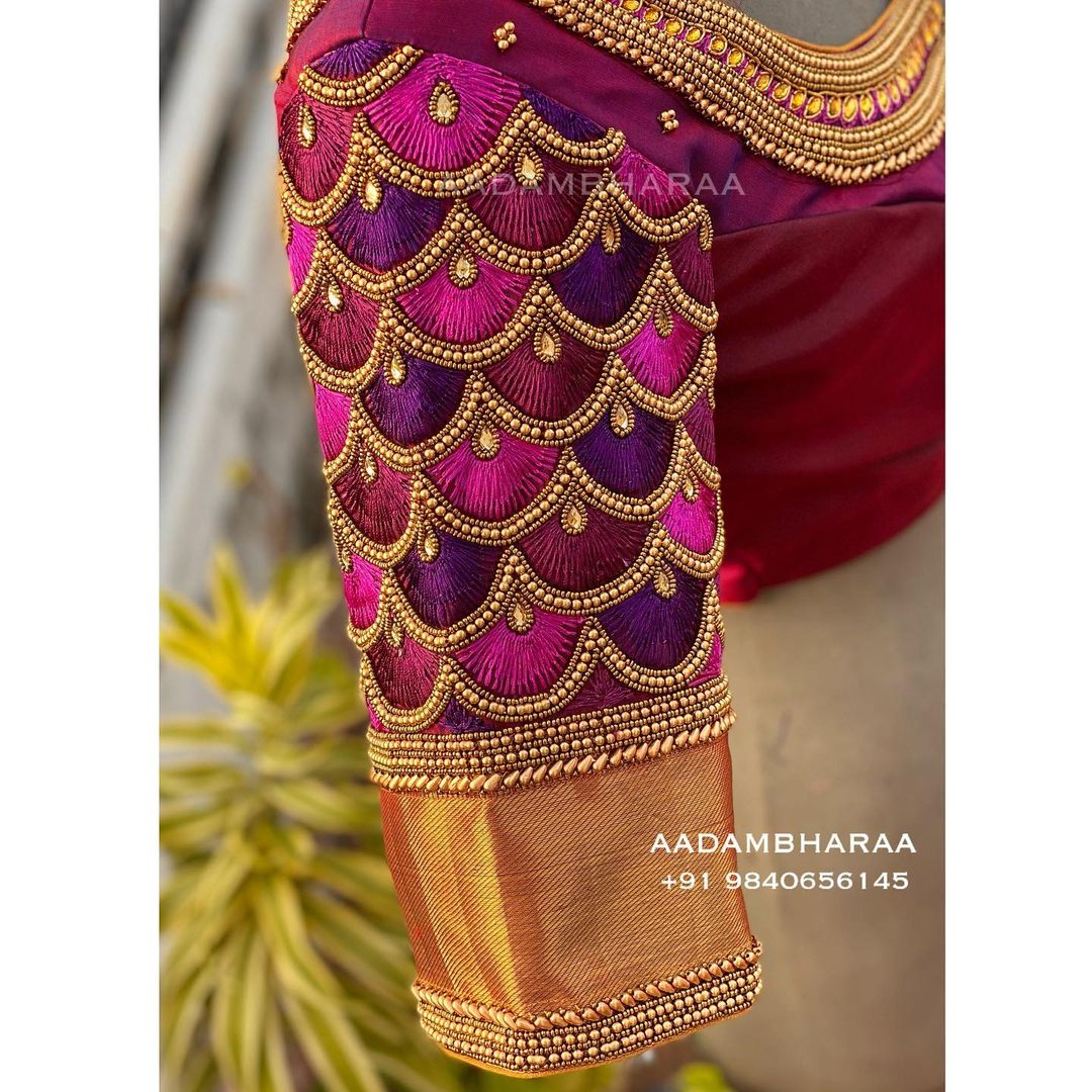 Here is a vibrant blouse by Aadambharaa that is hand embroidered with thread work that will make you stand out. 2021-04-02