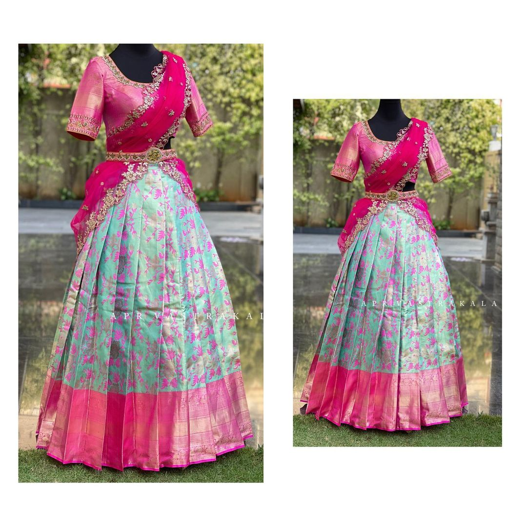 Gorgeous ice blue and pink color combination pattu floral lehenga and blouse with net dupatta. Duaptta with hand embroidery cut work.  2021-04-02