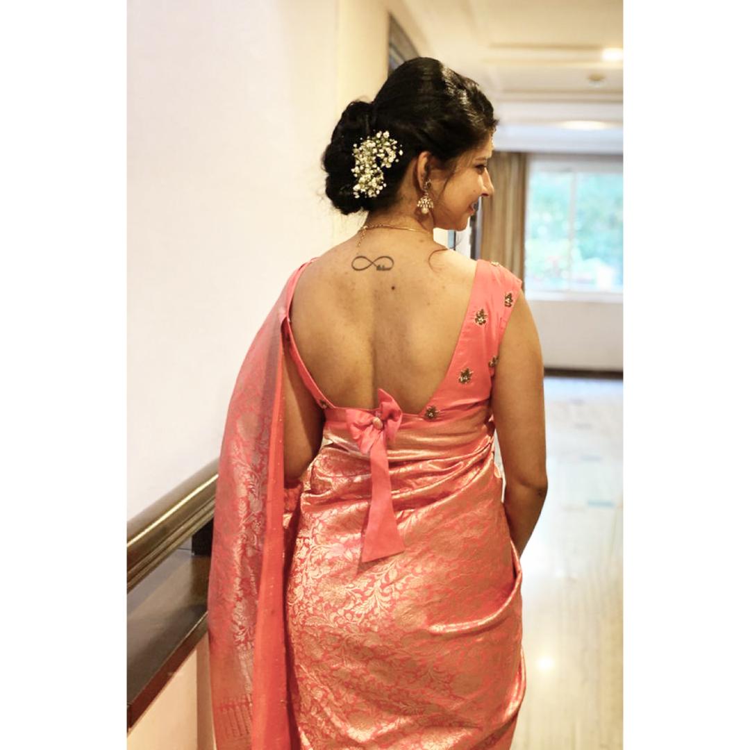 Gorgeous rose pink Banarasi silk saree with silver zari designs!  Anya customized pink silk blouse with bowknot design and zardozi embellishments.  2021-04-03