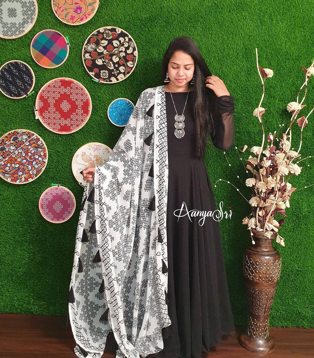 Beautiful black color  floor length long frock with muggu print white dupatta. Price : RS. 2950. 2021-04-03