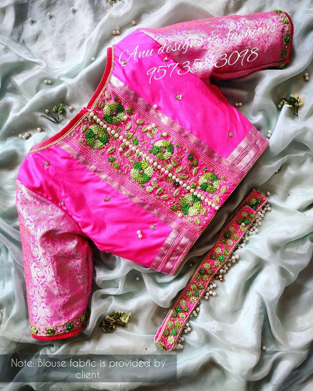 Gorgeous pink color designer blouse with floral design 3D maggam work. Blouse with maggam work waist belt. Only blouse cost is Rs.9500/- includes embroidery and stitching. Blouse fabric is provided by client. Belt cost is Rs.4500/- 2021-04-03